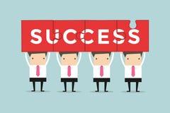 Puzzle della tenuta di lavoro di squadra dell'uomo d'affari il successo di parola Immagini Stock