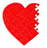 Puzzle denteux inachevé dans une forme d'un coeur photographie stock libre de droits