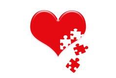 Puzzle des Herzens im roten Herzen Stockbilder