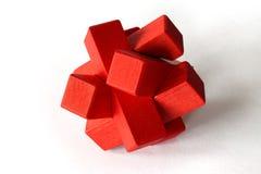 Puzzle di legno rosso Fotografia Stock Libera da Diritti