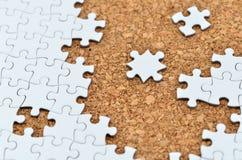 Puzzle di puzzle bianco. Immagine Stock