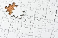 Puzzle di puzzle bianco. Fotografie Stock