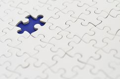 Puzzle di puzzle bianco normale. Fotografia Stock Libera da Diritti