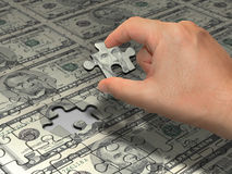 Puzzle Dollar. Wealth idea in a metaphor in the last piece of the puzzle to reach the wealth. That is the main piece of the puzzle to do the wealth Royalty Free Stock Images