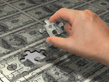 Puzzle Dollar. Wealth idea in a metaphor in the last piece of the puzzle to reach the wealth. That is the main piece of the puzzle to do the wealth Royalty Free Stock Photos