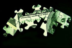 Puzzle dollar. Pieces of puzzle from american dollar on black background stock photo