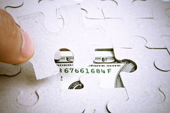 Puzzle and Dollars Royalty Free Stock Photography