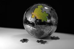 Puzzle du globe 3d du monde Images libres de droits