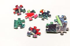 Puzzle e pezzi di puzzle Fotografia Stock