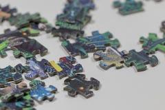 Puzzle e pezzi di puzzle Fotografie Stock Libere da Diritti