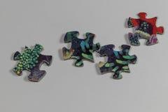 Puzzle e pezzi di puzzle Immagine Stock Libera da Diritti