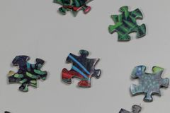 Puzzle e pezzi di puzzle Fotografie Stock