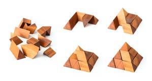Puzzle en bois de pyramide Photographie stock