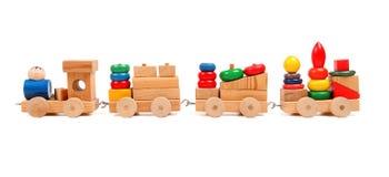 Puzzle en bois de train avec des entraîneurs Photographie stock libre de droits