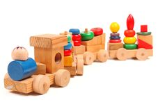 Puzzle en bois de train avec des entraîneurs Images libres de droits