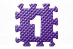 Puzzle en caoutchouc avec le numéro 1 Images stock