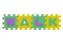 Puzzle en caoutchouc formant une promenade de mot Image stock