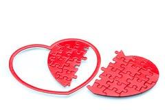 Puzzle en forme de coeur fendu, relation cassée Photo libre de droits