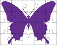 Puzzle et papillon Photographie stock