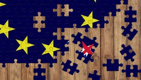 Puzzle from eu flag and missing parts of british flag in star shape royalty free stock image