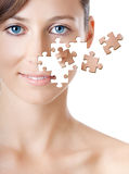 Puzzle Face. Healh concept image - Beautiful young woman with puzzle pieces Royalty Free Stock Photography