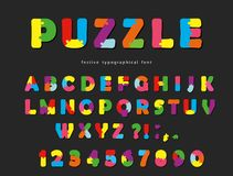 Puzzle font. ABC colorful creative letters and numbers on a black background. Stock Images