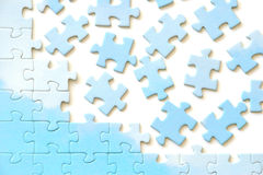 Puzzle frame. Frame from puzzle pieces. White background Stock Photos