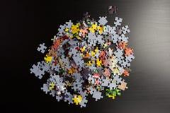 puzzle frame on black background Stock Photos