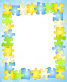 Puzzle Frame Border Background. An border background featuring colourful jigsaw puzzle pieces in blue, green, yellow and white Stock Photo