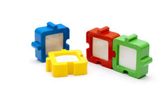 Puzzle Frames. Puzzle photo frames in a row, in various colors, and isolated on white background Royalty Free Stock Photography