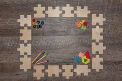 Wooden puzzle frame encouraging early learning stock photos