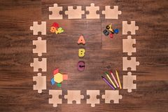 Wooden puzzle frame esrlylearning stock photos