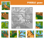 Puzzle Game for children with animals (iguana) Royalty Free Stock Photo