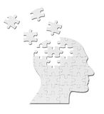 Puzzle game solution head silhouette mind brain. Close up of a puzzle game parts on a head silhouette Stock Photography