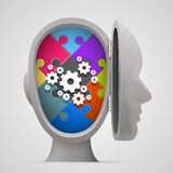 Puzzle and gears in the open head Royalty Free Stock Photos