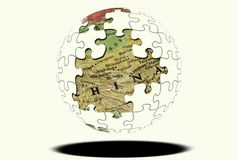 Puzzle Globe. Puzzle Sphere with Map Showing THrough Missing Pieces Stock Image