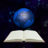 Puzzle globe and book in universe Royalty Free Stock Image