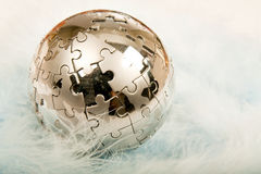 Puzzle Globe on feather. Puzzle Globe on very soft feather Royalty Free Stock Photography
