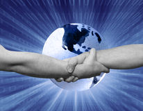 Puzzle globe handshake. Handshake&glowing puzzle earth globe Royalty Free Stock Images