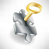 Puzzle and golden key Royalty Free Stock Photos