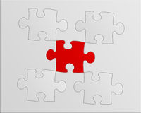 Puzzle. Gray puzzle with a red piece stock photos