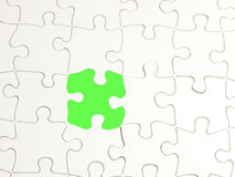Puzzle on green 1. Picture of puzzle with missing piece - green fill Royalty Free Stock Photo