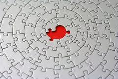 Puzzle grigio con una parte mancante Fotografie Stock Libere da Diritti
