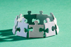 Puzzle group shadow. A group of small upright jigsaw puzzle pieces Stock Photo