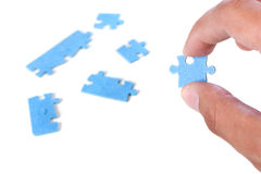 Puzzle and hand Royalty Free Stock Image