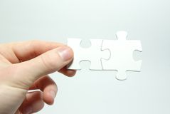Puzzle in hand Royalty Free Stock Photos