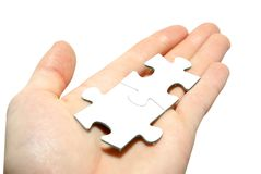 Puzzle in hand Stock Photography