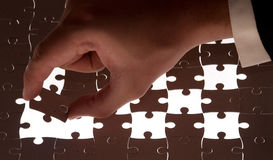Puzzle and hand Royalty Free Stock Photography