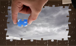 Puzzle and hand Royalty Free Stock Photo