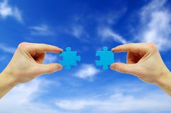 Puzzle in hand Royalty Free Stock Photography